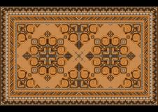 Luxury vintage oriental carpet with brown,gray and yellow shades on black background royalty free stock photo
