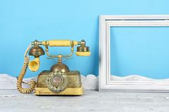 Luxury Vintage telephone and white frame. Stock Images