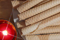 Luxury wafers with shiny burning candle Royalty Free Stock Images