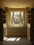 Luxury Walk-in Closet. Luxury Walk in Closet with window and shelves stock photography