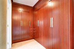 Luxury wardrobe room with brown modern built-in cabinets Royalty Free Stock Image
