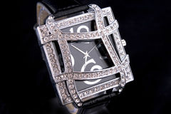 Luxury Watch. Woman luxury watch in silver tone with crystals on black background stock photos