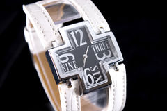 Luxury Watch. Closeup of luxury white woman watch lie cross on black background royalty free stock images