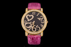 Luxury Watch. Woman luxury watch in golden tone with crystals and ping strap royalty free stock photo