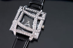 Luxury Watch. Woman luxury watch in silver tone with crystals on black background royalty free stock photography