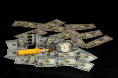 Luxury watch with an cuban cigar laying on 100 dollar bills Stock Images