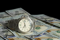 Luxury watch and 100 dollar bills Stock Photography