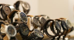 Luxury men`s watches at the store stock photos