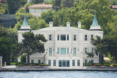 Luxury water front villa on river Royalty Free Stock Images