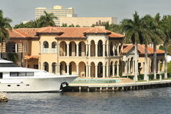 Luxury Waterfront. Modern waterfront home with yacht on the intercoastal in south Florida neighborhood stock photos