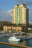 Luxury waterfront apartment building. Highrise apartment building located at waterfront with adjacent marina with boats Stock Images