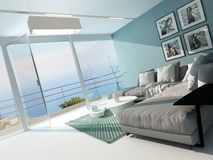 Luxury waterfront apartment living room. With a floor-to-ceiling glass window overlooking the ocean with patio doors and an aquamarine accented side wall and Stock Photo