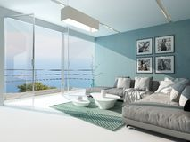 Luxury waterfront apartment living room. With a floor-to-ceiling glass window overlooking the ocean with patio doors and an aquamarine accented side wall and Stock Photography