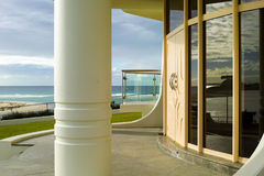 Luxury waterfront building entrance with door and pillar on beach. Luxury waterfront building entrance with door and pillar. Modern residential architecture on stock photo