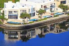 Luxury holiday homes waterfront. Waterfront situated holiday homes with swimming pools - at the Gold Coast, Australia Stock Photography