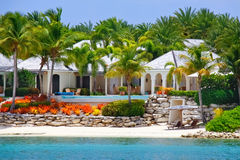 Luxury waterfront house with pool on Antigua. A fantastic waterfront villa on Long Island, a small outlying island off the Caribbean island of Antigua royalty free stock image
