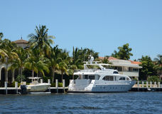 Luxury waterfront property and yacht Royalty Free Stock Image