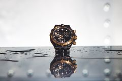 Luxury waterproof watches in water splashes. Luxury beautiful waterproof watch in water splashes royalty free stock image