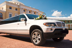 Luxury wedding. Car in front of The Grand Palace at Pavlovsk, Russia Royalty Free Stock Photography