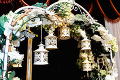 Luxury wedding altar decorated with white roses, greenery and li Stock Photos