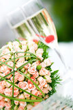 Luxury wedding bouquet of roses with champagne Royalty Free Stock Photography
