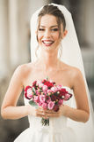 Luxury wedding bride, girl posing and smiling with bouquet Royalty Free Stock Photos