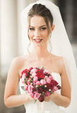 Luxury wedding bride, girl posing and smiling with bouquet Stock Photo