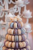 Luxury wedding candy bar table set. Macaron tower or pyramid and cupcakes on sweet dessert table. Pastel stylish colours., sweets, treats stock photo