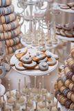 Luxury wedding candy bar table set. Macaron tower or pyramid and cupcakes on sweet dessert table. Pastel stylish colours., sweets, treats royalty free stock photography