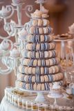 Luxury wedding candy bar table set. Macaron tower or pyramid and cupcakes on sweet dessert table. Pastel stylish colours., sweets, treats royalty free stock images
