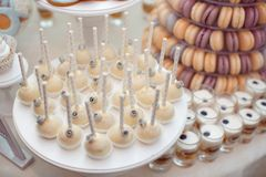 Luxury wedding candy bar table set. Macaron tower or pyramid and cupcakes on sweet dessert table. Pastel stylish colours., sweets, treats royalty free stock photo