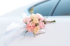 Luxury wedding car decorated with flowers Stock Images