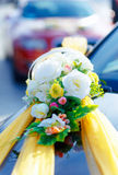 Luxury wedding car decorated with flowers. White flower and ribbons. Stock Photo