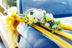 Luxury wedding car decorated with flowers. White flower and ribbons. Stock Images