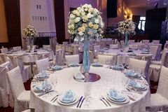 Luxury wedding decor with flowers and glass vases with jewels on Stock Image