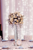Luxury wedding decor with flowers and glass vases and number one Royalty Free Stock Images