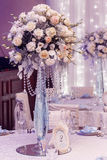 Luxury wedding decor with flowers and glass vases and number of Royalty Free Stock Image