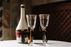 Luxury wedding decorated champagne bottle and glasses in the royal style Royalty Free Stock Photo