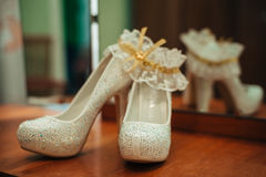 Luxury wedding Elegant bridal shoes and white Royalty Free Stock Images
