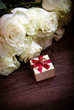 Luxury wedding gift box with rose bouquet royalty free stock images