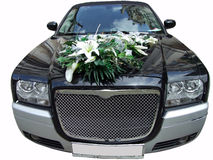 Luxury wedding limousine with bouquet Stock Images