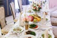 Luxury wedding reception in restaurant. stylish decor and adorning. Restaurant table with food.  stock image