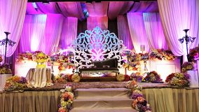 Luxury wedding stage in front view. Luxury malay traditional wedding stage in front view decorated with light and colorful curtains to celebrate the brides royalty free stock photography