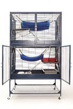 Luxury well equipped ferret cage on white background. Well equipped ferret home in two floor luxury cage Stock Photography