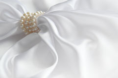 Luxury white background with silk and pearl Royalty Free Stock Photo