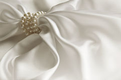Luxury white background with silk and pearl. Beautiful silk drap Royalty Free Stock Photo