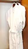 luxury white bathrobes hanging Stock Photos