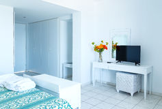 Luxury white bedroom with TV and mirrow in the apartment. Stock Photo