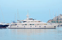 White yacht. Luxury white boat comes to the marina Royalty Free Stock Images