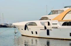Luxury boats. Luxury white boat in the marina Stock Photo